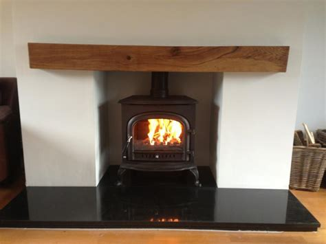 Logburner lining of fireplace with board & paint advice