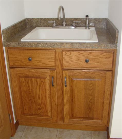 utility sink with base cabinet pennwest homes