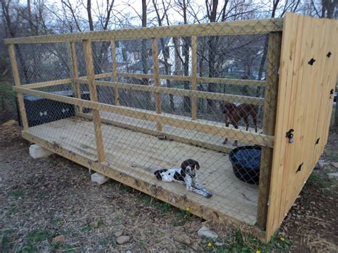 dog running around house dog kennel outdoor run i like this but i would put a roof on it and put a foot of