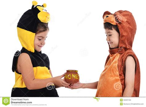 young girl honey pot bee costume and bear costume stock images image 34431134