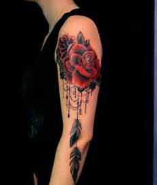 lace and roses become a feminine dreamcatcher tattoo