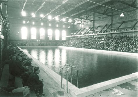 The Field House by Iowa City Past Swimming Pool With Crowd At The Field