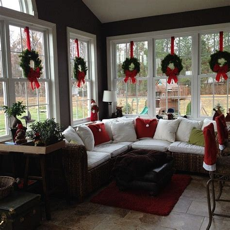 sunroom one word or two love the wreaths suspended with red ribbon in the windows