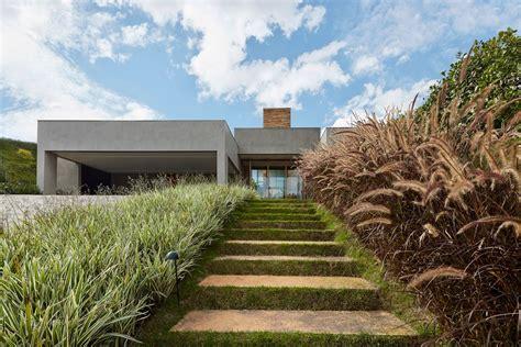 garden between houses modern house in brazil hides glorious tropical garden curbed