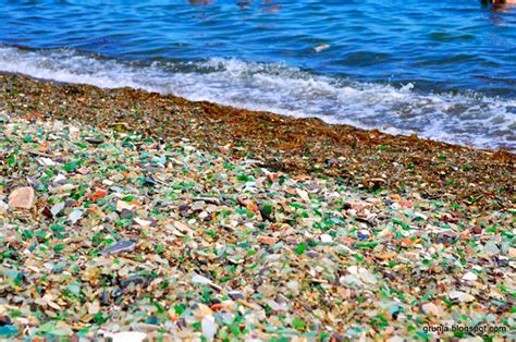 russian beach russians throw away empty vodka and beer bottles ocean turns them into colorful glass pebbles