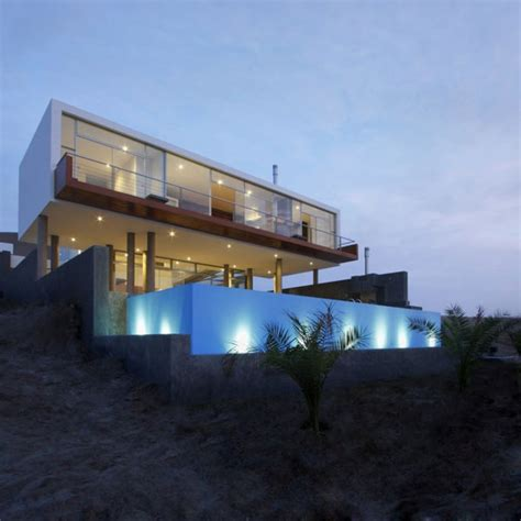 modern beach house contours following the sloped terrain