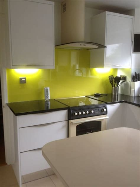 yellow splashback kitchen white gloss kitchen with yellow glass splashback by henley