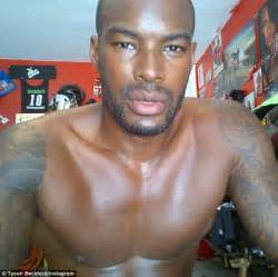 tyson beckford flashes his impressive six pack and bulging