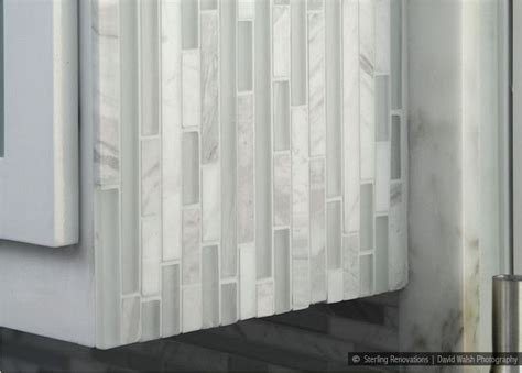glass marble white backsplash tile installed vertically in