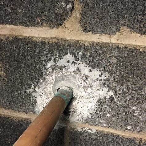 cinderblock   Copper pipe through cinder block wall