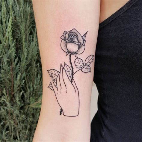 tattoo of a hand holding flowers 15 best tattoo images on pinterest hand tattoos little