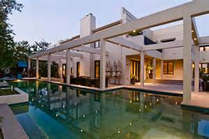 Big contemporary house with dark interior filled with light digsdigs