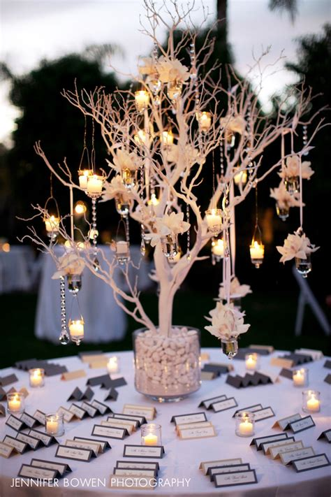 A Closer Look At The Gorgeous Seating Card Table With A White Tree Centerpieces