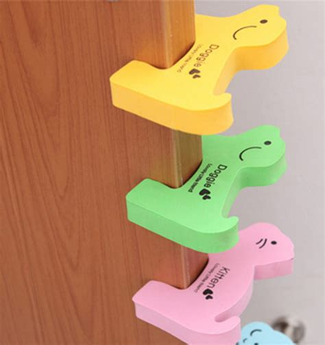 Baby Proof Door Stopper by Other Baby Proofing Baby Safety Door Stopper Yellow