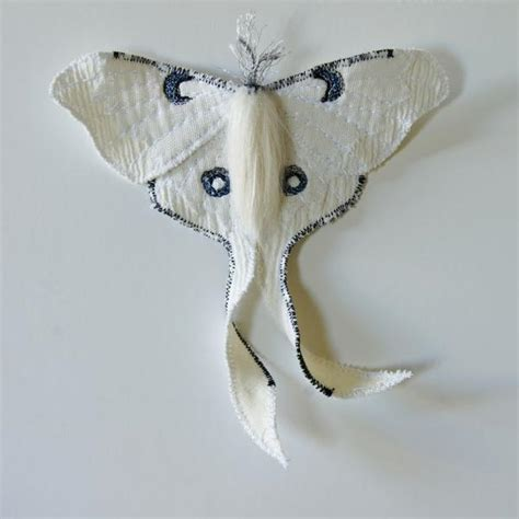 white luna moth brooch created  collaboration  nuit clothing ate blue terracotta