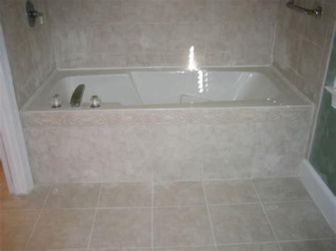 tile front of bathtub tile work after the tub front was originally sheetrock