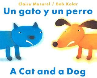 un gato a cat un gato y un perro a cat and a dog by claire masurel