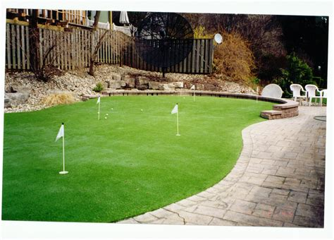 golf backyard practice after easyturf custom putting green complete with pet