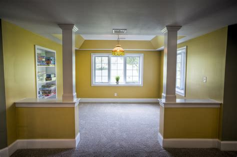 this archetypical 50 s rec room basement features the finished basement malvern traditional basement