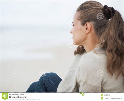 woman looking into distance royalty free stock photos image 5371368 young woman sitting on lonely beach and looking into