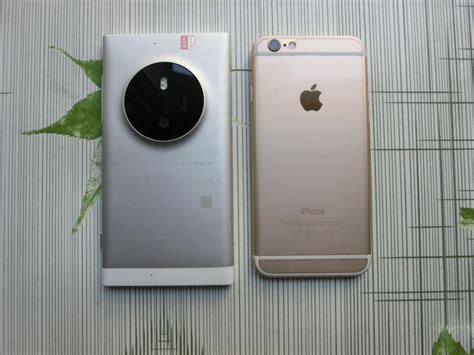 Hp Nokia Rm 1030 lumia 1030 aka rm 1052 prototype compared with iphone 6 in