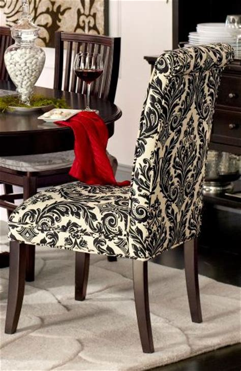 dining chairs in statement damask are dramatic and