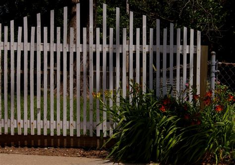 awesome wood material creating unique fence ideas designed with stripes style covering cool white colored wooden fence which is created using unique fence ideas that