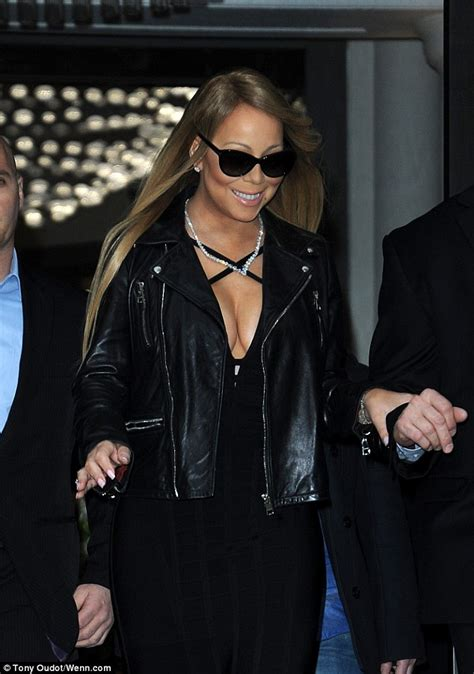 who is the singer in the new direct tv ad newhairstylesformen2014 mariah carey puts on a very busty display ahead of cardiff