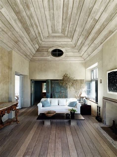 the white washed wood ceiling the reclaimed wood floor