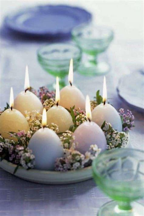 candele e fiori centrotavola con fiori foto design mag