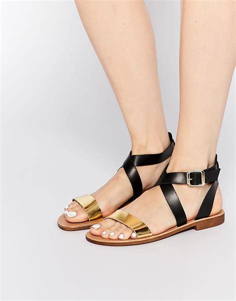 black and gold flat sandals dune lottie gold black flat sandals in metallic lyst