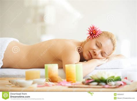 girl lying bed with flowers young woman on spa treatment royalty free stock