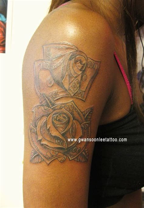 dollar rose tattoo dollar bills money roses design on arm flower