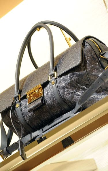 Andre Talley His Louis Vuitton Monogram Purse by Louis Vuitton And Vogue Celebrate The Cruise 2011 Rtw