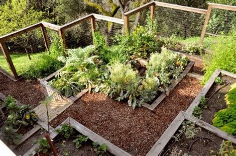 uneven backyard terraced garden boxes are a great solution for those with