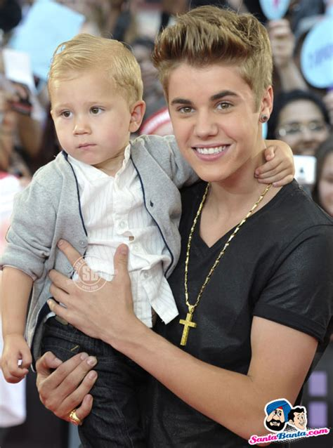 justin bieber biography siblings justin bieber carries his younger brother jaxon as he