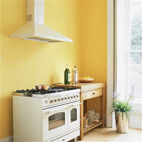 yellow kitchen with range cooker and butcher s table housetohome co uk