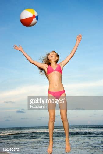 preteen beach caucasian preteen girl playing with beachball on beach