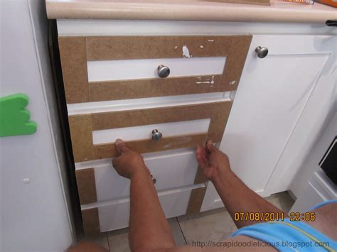 adding trim to cabinet doors scrapidoodlelicious beadboard wallpaper in kitchen cabinets