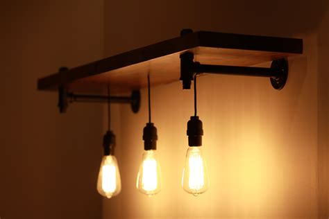Shelf Lights by Rustic Wood And Pipe Shelf With Pendant Lighting