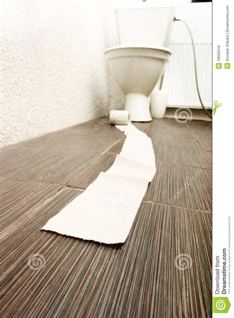 toilet paper on bathroom floor stock image image 18556479