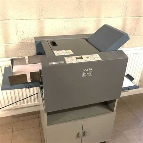 Used Paper Folding Machine - ex demo used duplo df1200 a3 automatic suction fed paper