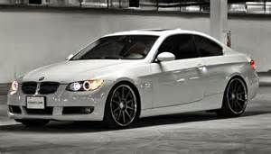 white bmw 328i with black rims