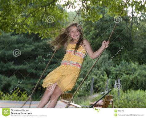 young swing young girl standing on tree swing stock image image 7285793