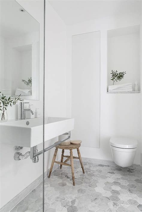 bathroom with grey tile floor 25 best ideas about grey white bathrooms on pinterest