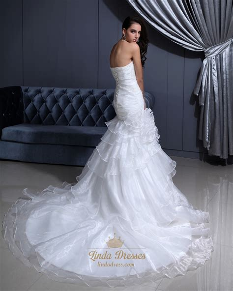 white sweetheart beaded organza wedding gown with tiered