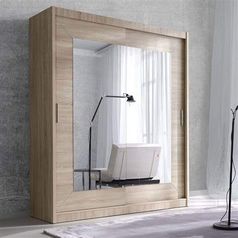 large wardrobe in oak color with sliding doors and mirror