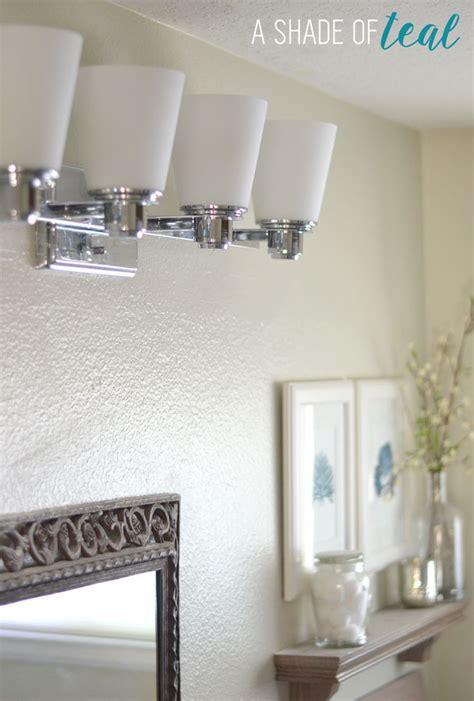 bathroom chronicles hall bath chronicles new light fixture a shade of teal