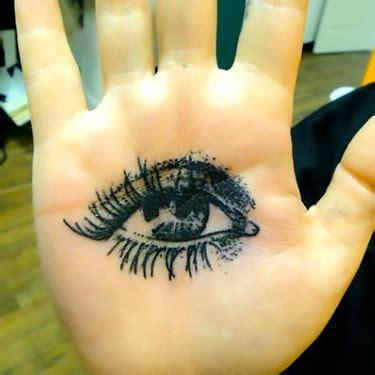 eye tattoo on palm meaning trash polka dead tree tattoo design