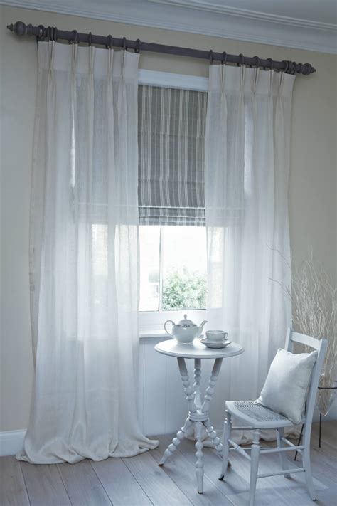 blinds and drapes dublin roman blind with clare voile curtains on pole